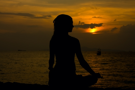 Healthy woman doing yoga outdoor, sunset over sea Stock Photo - 13656835