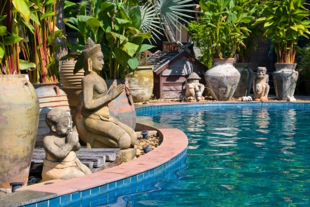 The stone Buddhist statues by the pool . Thailand . Stock Photo - 13692101