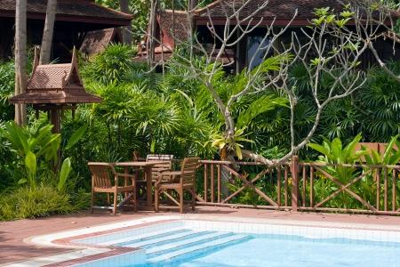 Swimming pool in garden . Thailand . photo