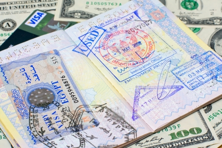 Passport with stamps with us dollar, concept of travel photo
