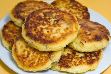 Delicious homemade cheese pancakes closeup in plate photo