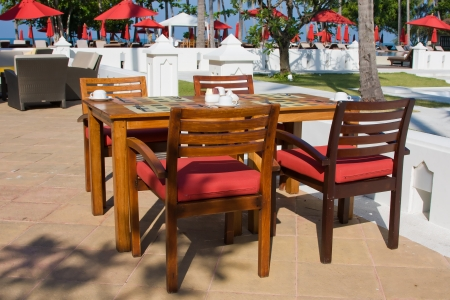 Table and chairs in empty cafe, Thailand. photo