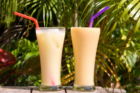 Pair of fruit shakes on the table photo