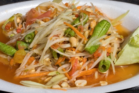 tam: Thai papaya salad also known as Som Tam from Thailand. Stock Photo