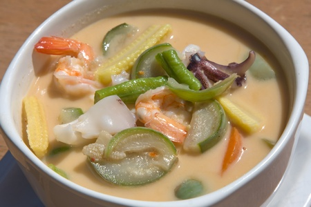Thai style spicy soup name is Tom Yum photo