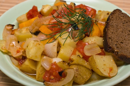 Ragout of vegetables on the plate photo