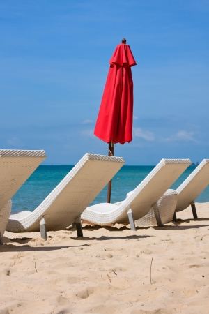 loungers: Sun loungers with an umbrella on the beach