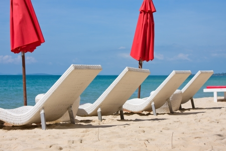 Sun loungers with an umbrella on the beach photo