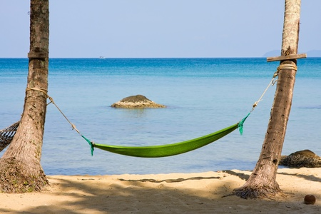 Empty hammock in the tropical beach, Thailand. Stock Photo - 14232422