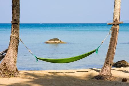 Empty hammock in the tropical beach, Thailand. Stock Photo - 14232422