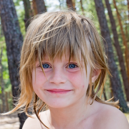 Cute little girl on the nature in summer day photo