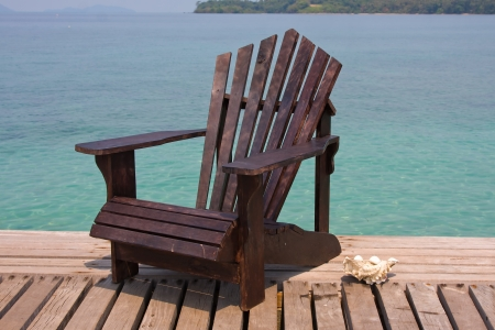 Chair on the shore near the sea in Thailand photo