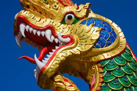 Dragon statue at a temple in Thailand photo