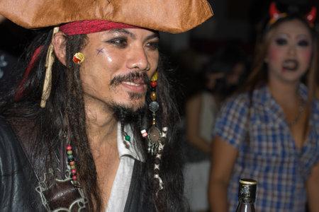 PATTAYA , THAILAND - OCTOBER 31 : Thai men celebrates Halloween on October 31 2011 in Pattaya, Thailand. Halloween has become popular in Thailand in recent years .