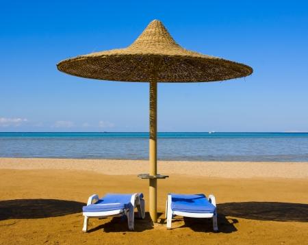 Straw umbrella on the beach, Egypt . Stock Photo - 15133366