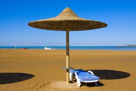 el sheikh: Straw umbrella on the beach, Egypt .
