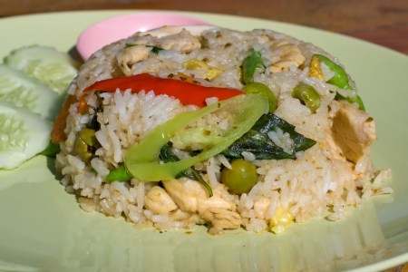 Rice with chicken and vegetables on the plate photo