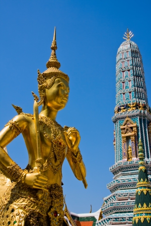Golden statue of Kinnara at Wat Phra Kaew in Bangkok, Thailand photo