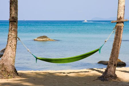 Hammock on a tropical beach photo