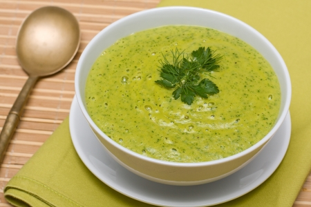 broth: Spinach cream soup in white bowl
