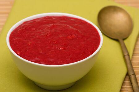 crimson colour: Red viburnum jam in white plate Stock Photo