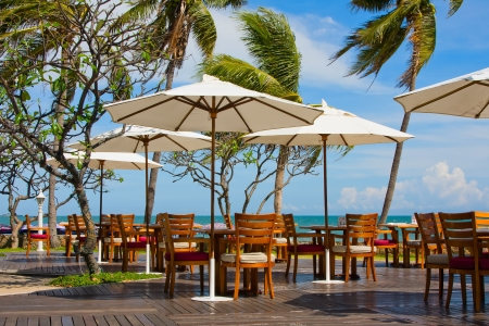restaurant exterior: Table and chairs with a beautiful sea view . Thailand .