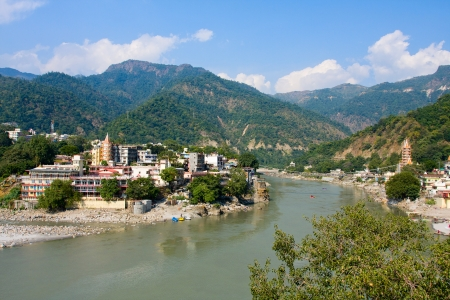 Holy Ganges river that flows through Rishikesh (the world capital of Yoga) - the holy city for the Hindus, India. Stock Photo