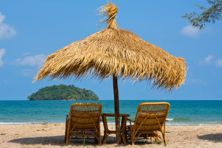 caribbean climate: Sun loungers with an umbrella on the beach