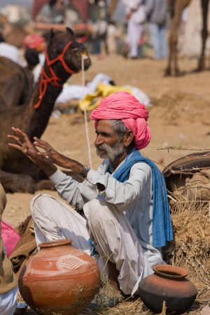 PUSHKAR, INDIA - NOVEMBER 21: An unidentified man attends the Pushkar fair ( Pushkar Camel Mela ) on November 21, 2012 in Pushkar, Rajasthan, India. Pilgrims and camel traders flock to the holy town for the annual fair.
