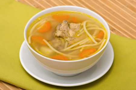 Chicken soup with noodle and vegetables photo