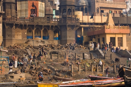 VARANASI, INDIA - November 30: Indian people burning corpses and then drown them in the Ganges on November 30, 2012 in Varanasi, India. River Ganges is regarded by Hindus as Holy.