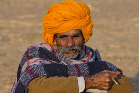 PUSHKAR, INDIA - NOVEMBER 23: An unidentified man attends the Pushkar fair ( Pushkar Camel Mela ) on November 23, 2012 in Pushkar, Rajasthan, India. Pilgrims and camel traders flock to the holy town for the annual fair.