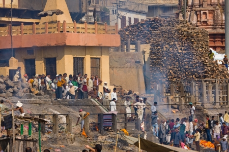 corpses: VARANASI, INDIA - DECEMBER 2: Indian people burning corpses and then drown them in the Ganges on December 2, 2012 in Varanasi, India. River Ganges is regarded by Hindus as Holy. Editorial