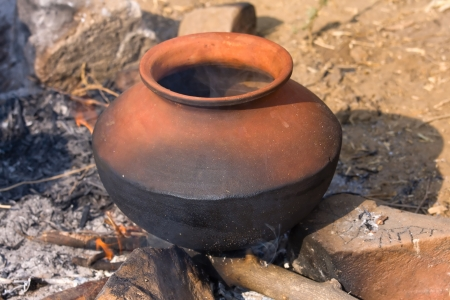 Clay pot with food on fire, India Stock Photo - 16878277
