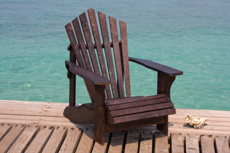 Chair on the shore near the sea in Thailand Stock Photo - 16878276