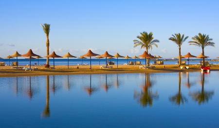 Straw umbrella on the beach, Egypt .