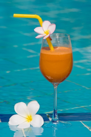 Tropical juice at the swimming pool photo