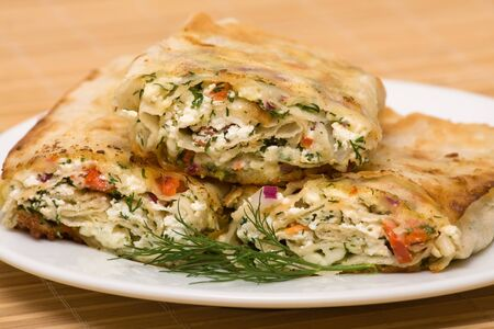 Pita bread wrapped with cottage cheese and vegetables photo