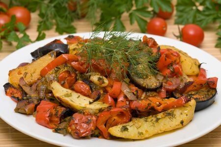 Traditional vegetable ratatouille on white plate Stock Photo - 17009828
