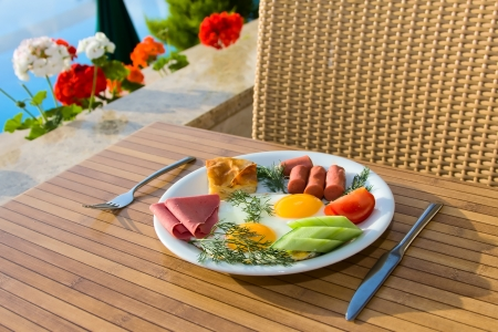 Breakfast served on a table near the swimming pool Stock Photo - 17009824
