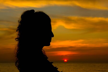 Silhouette of a girl at sunset Stock Photo - 17009718