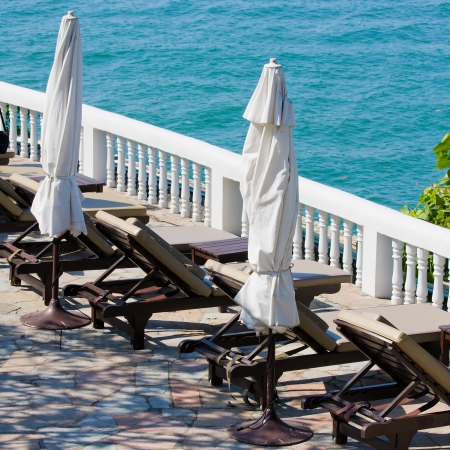 Chaise lounges by the sea in Thailand Stock Photo - 17029446
