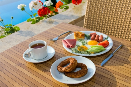 Breakfast served on a table near the swimming pool Stock Photo - 17038385