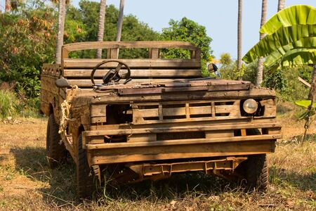Old wooden car in the jungle . Thailand . Stock Photo - 17043538