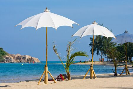 Umbrella on the beach on island Koh Phangan, Thailand. photo