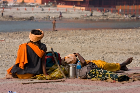 underprivileged: HARIDWAR, INDIA - NOV 8: An unidentified homeless people are on the sidewalk near the River Ganges on November 8, 2012 in Haridwar, India. Poor Indians flock to Haridwar for charity. Editorial