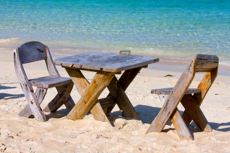Table and chairs with a beautiful sea view on island Koh Phangan, Thailand. photo