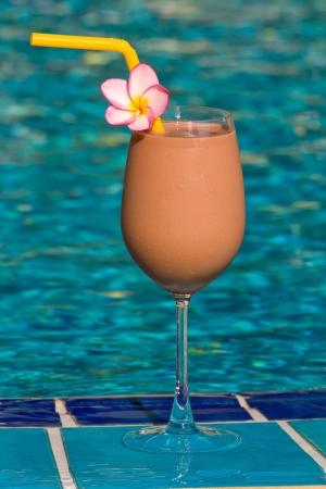 chocolate shake: Chocolate shake at the swimming pool Stock Photo