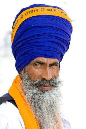 Portrait of Indian sikh men in turban with bushy beard photo