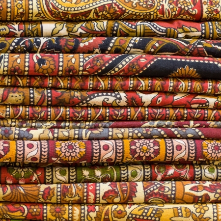 Heap of cloth fabrics at a local market in India. Close up . Stock Photo